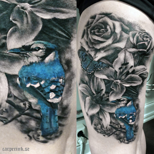 Carper Ink Blue Bird Butterfly Lilies Roses Tattoo